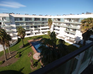 Duplex penthouse with parking for sale in Rosas Costa Brava with  for sale with communal swimming pool and garden, 180.000 Euros
